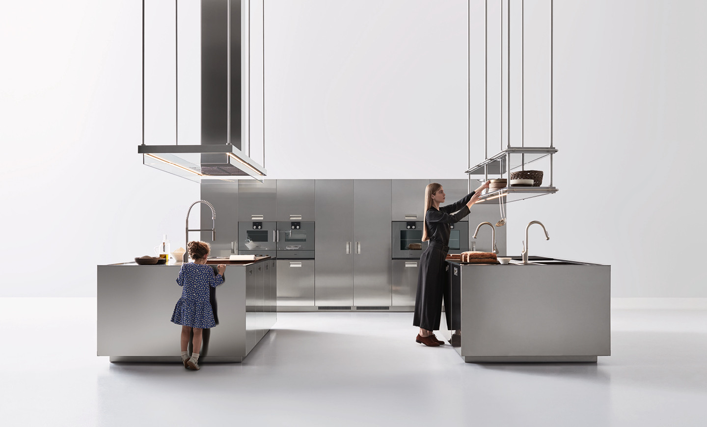 the italia project with double operational island accessorised wall isola hood with glass border and double shelf makes highly professional kitchens a - Professional Kitchen